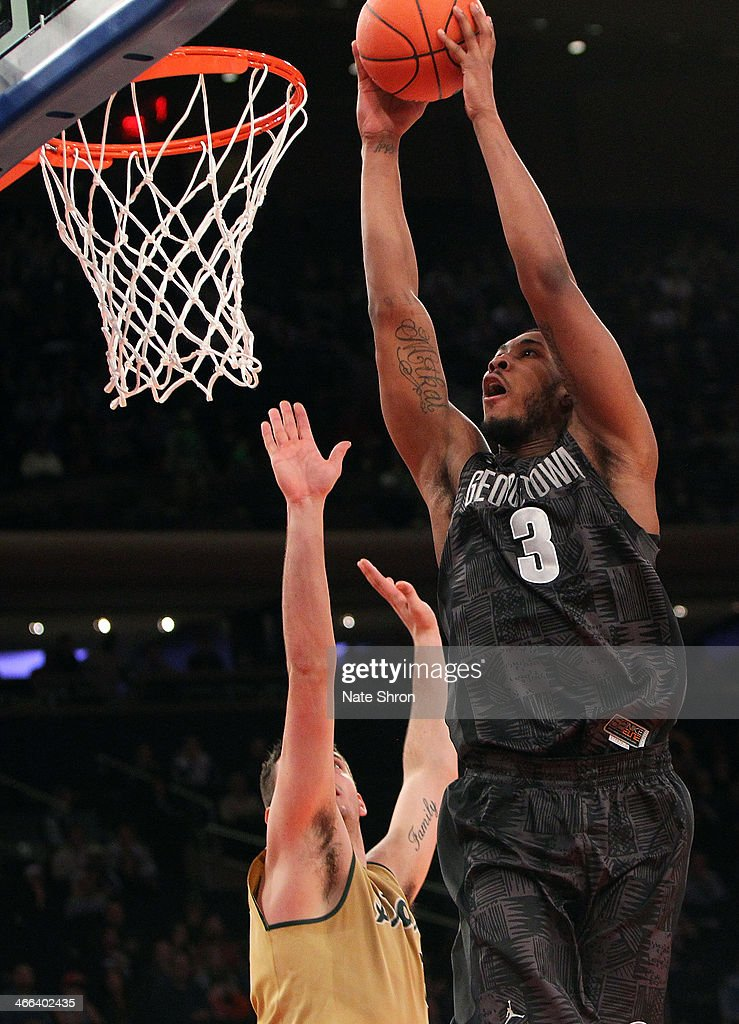 Mikael Hopkins #3 of the Georgetown Hoyas dunks the ball over Kenny Kaminski #30 of the Michigan State Spartans during the game at Madison Square Garden on February 1, 2014 in New York City.