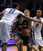 Mikael Hopkins of the Georgetown Hoyas is fouled by Forrest Robinson of the DePaul Blue Demons at the Allstate Arena on February 3 2014 in Rosemont...