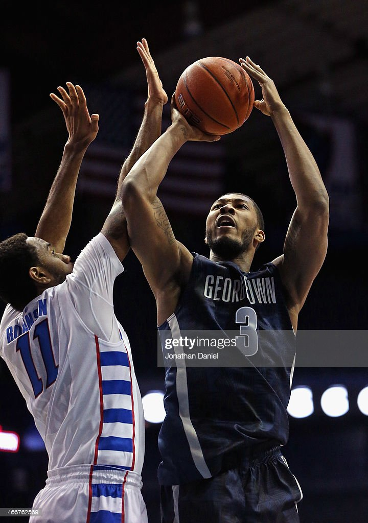 Mikael Hopkins #3 of the Georgetown Hoyas puts up a shot against Forrest Robinson #11 of the DePaul Blue Demons at the Allstate Arena on February 3, 2014 in Rosemont, Illinois.