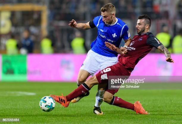Mikael Ishak of Nuernberg challenges Felix Platte of Darmstadt during the Second Bundesliga match between SV Darmstadt 98 and 1 FC Nuernberg at...