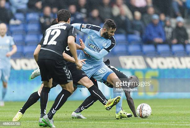 Mikael Ishak of Randers FC and Adama Guira of SonderJyskE compete for the ball during the Danish Alka Superliga match between Randers FC and...
