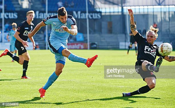 Mikael Ishak of Randers FC and Pierre Kanstrup of Sonderjyske compete for the ball during the Danish Alka Superliga match between Randers FC and...