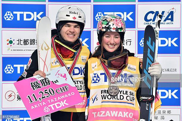 Mikael Kingsbury of Canada and Chloe DufourLapointe of Canada pose with their gold bib during the FIS Freestyle Ski World Cup Tazawako In Akita...