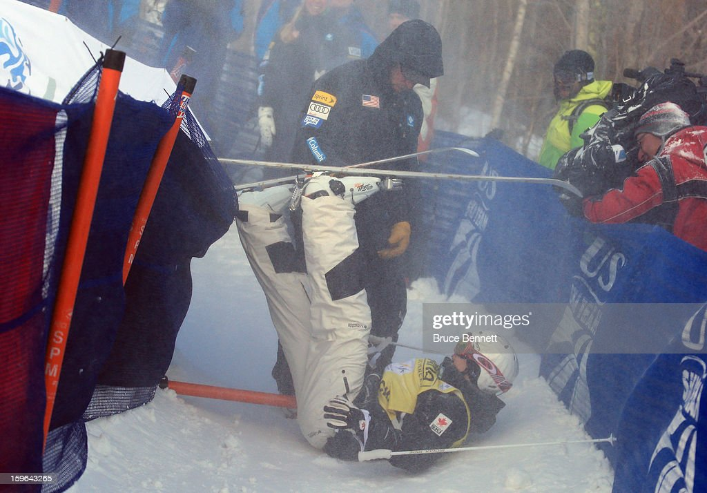 Mikael Kingsbury of Canada bursts through the safety fence while winning the USANA Freestyle Men's World Cup Moguls competition at Whiteface Mountain on January 17, 2013 in Lake Placid, New York.