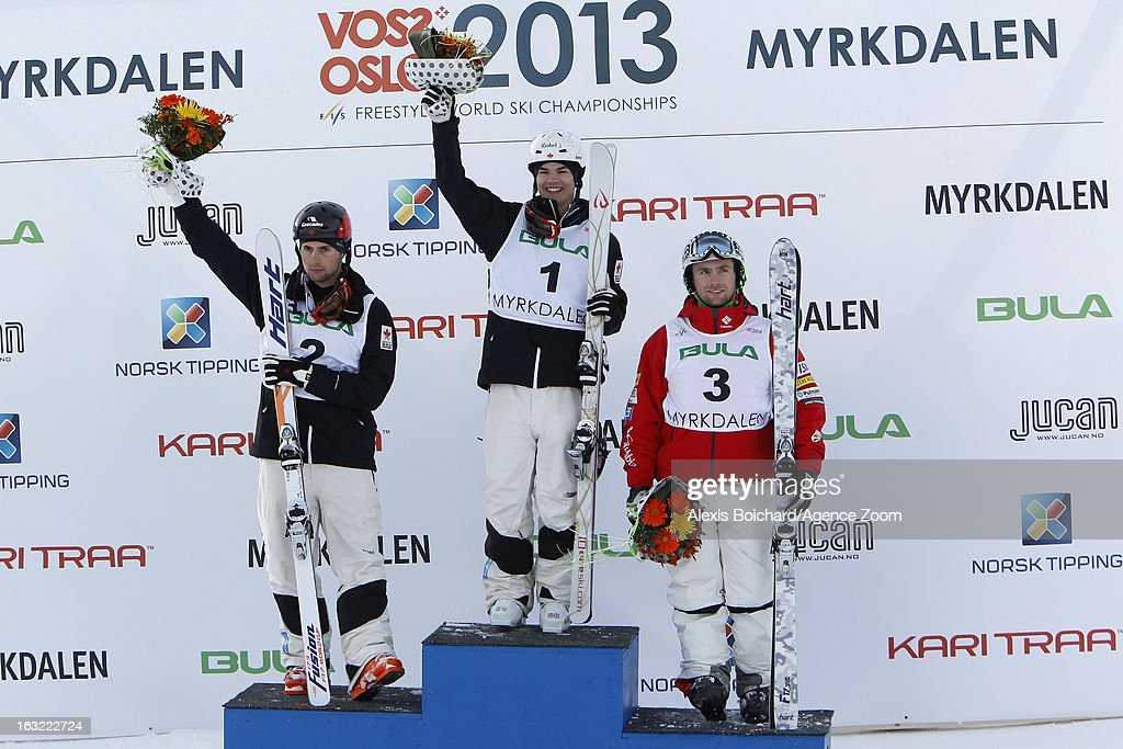 Mikael Kingsbury (C) of Canada takes 1st place, Alex Bilodeau (L) of Canada takes 2nd place, and Patrick Deneen of the USA takes 3rd place during the FIS Freestyle Ski World Championship Men's and Women's Moguls on March 06, 2013 in Voss, Norway.