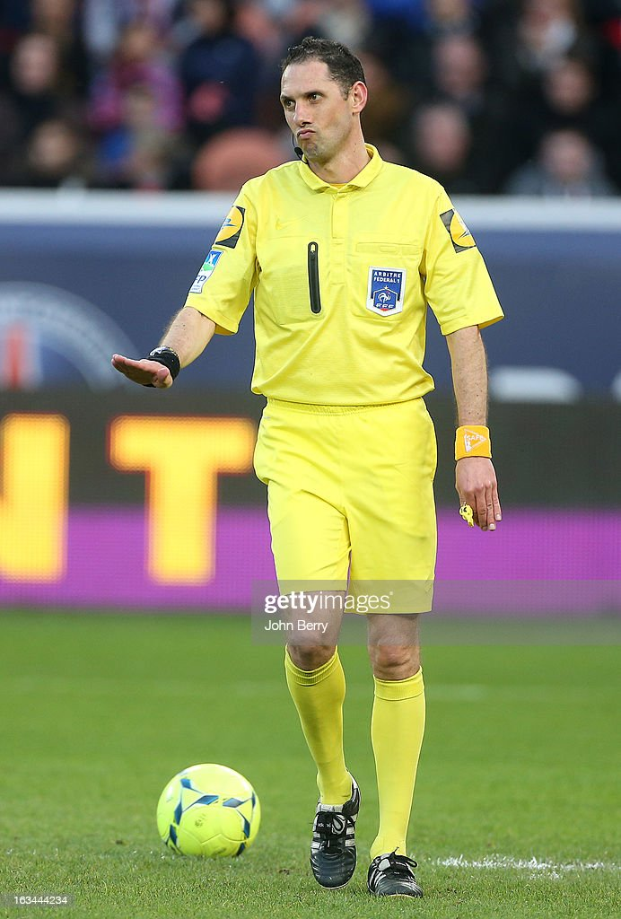 Mikael Lesage, referee, looks on during the french Ligue 1 match between Paris Saint-Germain FC and AS Nancy-Lorraine ASNL at the Parc des Princes stadium on March 9, 2013 in Paris, France.
