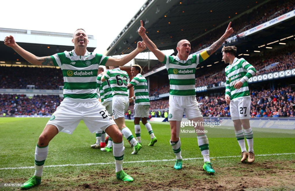 Mikael Lustig (L) and Scott Brown of Celtic celebrate their team's third goal scored by Callum McGregor during the Ladbrokes Scottish Premiership match between Rangers and Celtic at Ibrox Stadium on April 29, 2017 in Glasgow, Scotland.