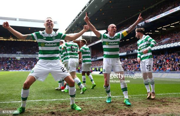 Mikael Lustig and Scott Brown of Celtic celebrate their team's third goal scored by Callum McGregor during the Ladbrokes Scottish Premiership match...