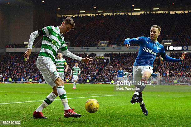 Mikael Lustig of Celtic and Barrie McKay of Rangers compete for the ball during the Ladbrokes Scottish Premiership match between Rangers and Celtic...
