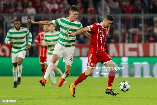 Mikael Lustig of Celtic and Robert Lewandowski of Bayern Muenchen battle for the ball during the UEFA Champions League group B match between Bayern...