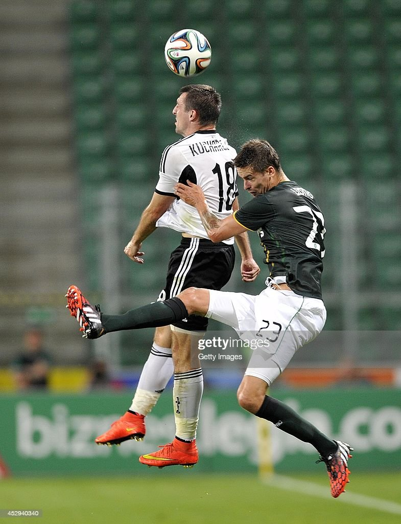Mikael Lustig of Celtic competes with Michal Kucharczyk of Legia during the third qualifying round UEFA Champions League match between Legia and Celtic at Pepsi Arena on July 30, 2014 in Warsaw, Poland.