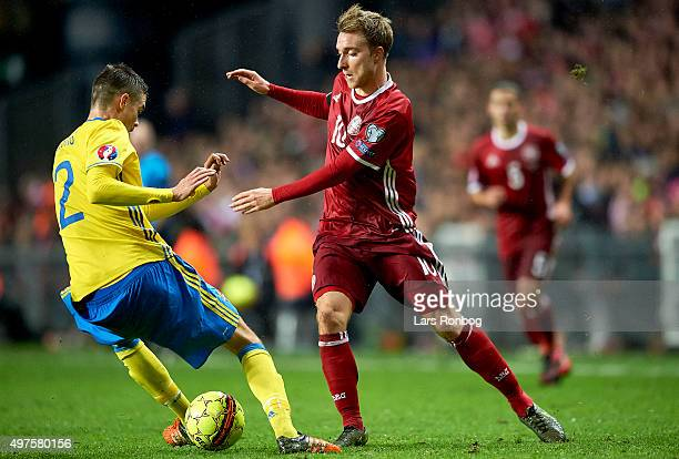 Mikael Lustig of Sweden and Christian Eriksen of Denmark compete for the ball during the UEFA EURO 2016 Qualifier PlayOff Second Leg match between...
