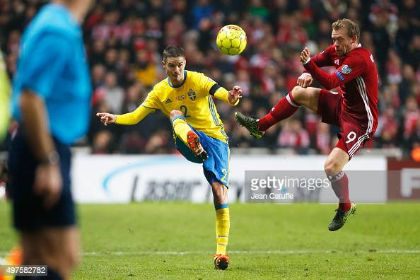 Mikael Lustig of Sweden and Michael KrohnDehli of Denmark in action during the UEFA EURO 2016 qualifier playoff second leg match between Denmark and...