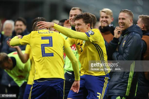 Mikael Lustig of Sweden and Victor Lindelof of Sweden celebrate at full time during the FIFA 2018 World Cup Qualifier PlayOff Second Leg between...