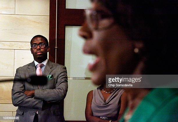 Mikael Moore chief of staff and grandson of Rep Maxine Waters listens to Waters address a news conference to challenge the charges made against her...