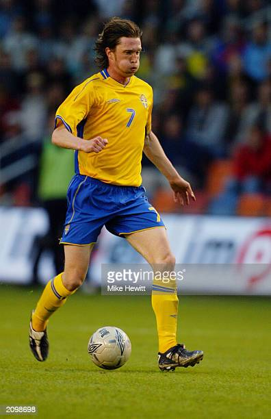 Mikael Nilsson of Sweden runs with the ball during the UEFA European Championships 2004 Group 4 Qualifying match between Sweden and Poland held on...