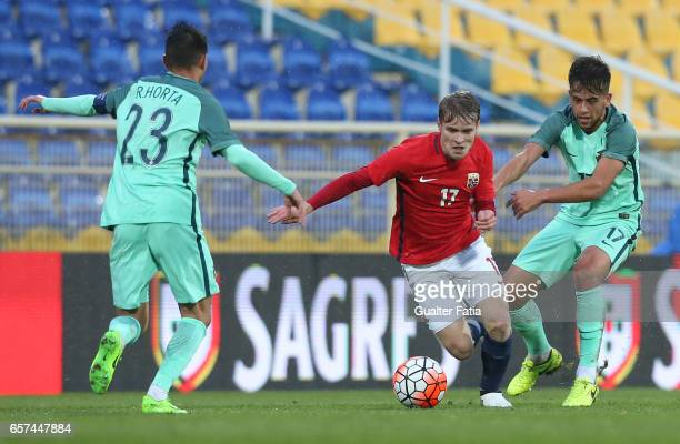 Mikael Noro Ingebrigtsen of Norway with Portugal midfielder Francisco Ramos and Portugal forward Ricardo Horta in action during the U21 International...
