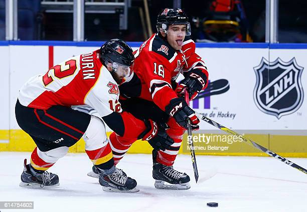 Mikael Robidoux of the Quebec Remparts and Mikael Sabourin of the Baie Comeau Drakkar battle for the puck during their QMJHL hockey game at the...