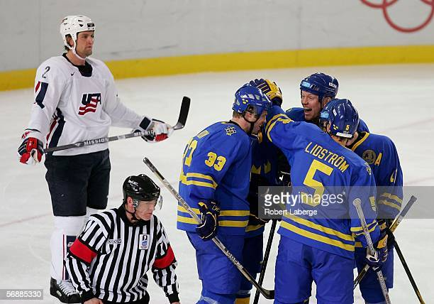 Mikael Samuelsson of Sweden celebrates with his teammates Fredrik Modin and Nicklas Lidstrom after he scored the second goal for Sweden during the...