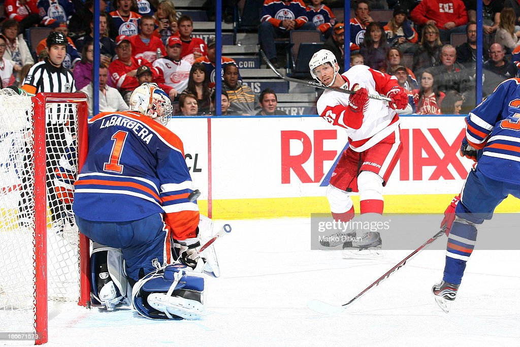 <a gi-track='captionPersonalityLinkClicked' href=/galleries/search?phrase=Mikael+Samuelsson&family=editorial&specificpeople=203085 ng-click='$event.stopPropagation()'>Mikael Samuelsson</a> #37 of the Detroit Red Wings takes a shot on net against <a gi-track='captionPersonalityLinkClicked' href=/galleries/search?phrase=Jason+LaBarbera&family=editorial&specificpeople=240674 ng-click='$event.stopPropagation()'>Jason LaBarbera</a> #1 of the Edmonton Oilers on November 2, 2013 at Rexall Place in Edmonton, Alberta, Canada.