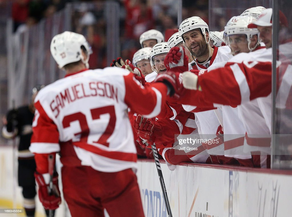 Mikael Samuelsson #37 of the Red Wings receives high fives from the bench after scoring a goal against the Anaheim Ducks in the second period in Game Five of the Western Conference Quarterfinals during the 2013 NHL Stanley Cup Playoffs at Honda Center on May 8, 2013 in Anaheim, California.