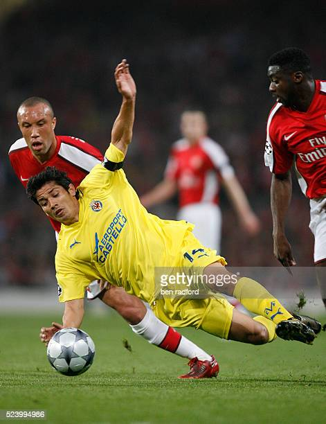Mikael Silvestre of Arsenal and Mati Fernandez of Villarreal during the UEFA Champions League Quarter Final 2nd Leg match between Arsenal and...
