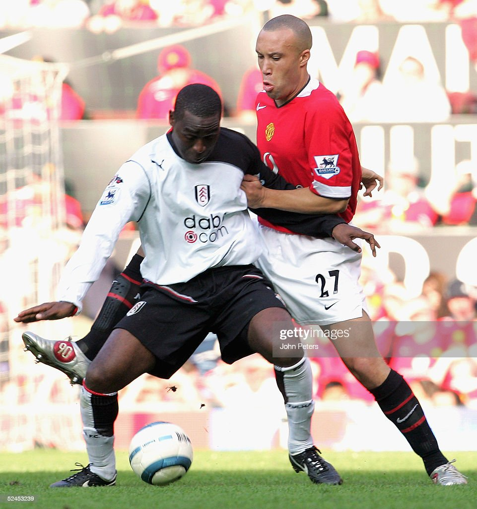 Mikael Silvestre of Manchester United clashes with Andy Cole during the Barclays Premiership match between Manchester United and Fulham at Old...