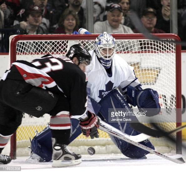 Mikael Tellqvist of the Toronto Maple Leafs get ready to stop the shot of Chris Drury of the Buffalo Sabres during a game at the HSBC Arena in...