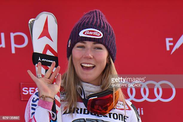 US Mikaela Schiffrin celebrates on the podium after winning the FIS Alpine Skiing World Cup Women Slalom on December 11 2016 in Sestriere Italian...