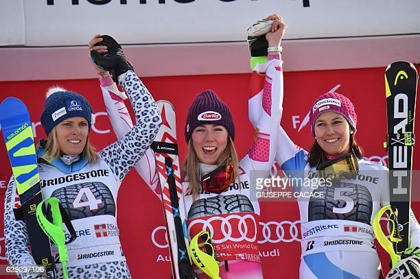 US Mikaela Schiffrin celebrates on the podium with Slovakia's Veronika Zuzulova second and Switzerland's Wendy Holdener third after winning the FIS...