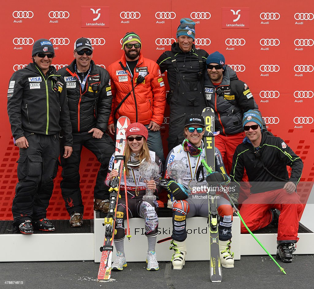 Mikaela Shiffrin and Ted Ligety pose with the crystal globes and support crew for the overall title in competes in the Audi FIS Alpine Skiing World Cup Finals Slalom on March 16, 2014 in Lenzerheide, Switzerland.