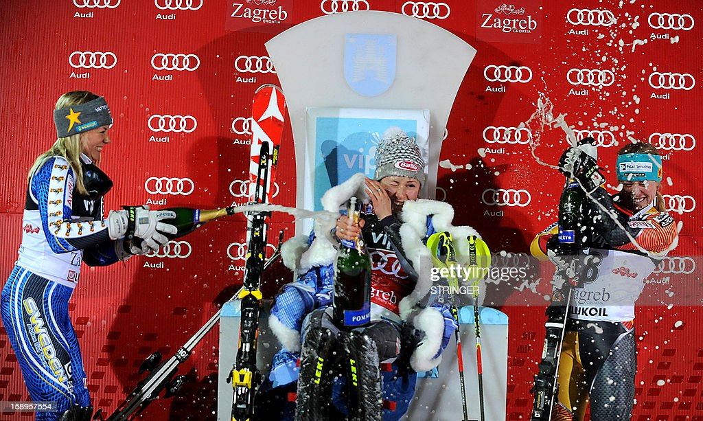 US Mikaela Shiffrin (C) celebrates after she won the women's FIS slalom competition race in Sljeme, near Zagreb, on January 4, 2013 while second placed Sweden's Frida Handsdotter (L) and third Canada's Mielzynski react during the trophy ceremony.