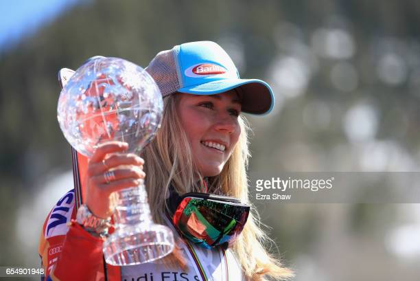 Mikaela Shiffrin of the United States celebrates with her globe for winning the season title for the ladies' Slalom during the 2017 Audi FIS Ski...