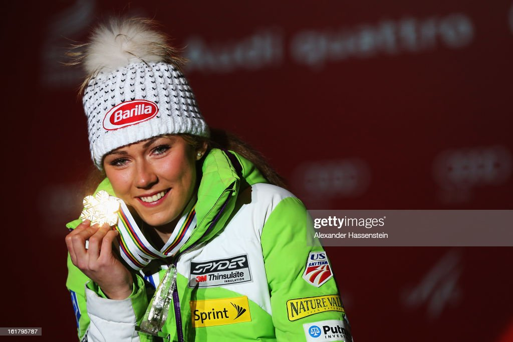 <a gi-track='captionPersonalityLinkClicked' href=/galleries/search?phrase=Mikaela+Shiffrin&family=editorial&specificpeople=7472698 ng-click='$event.stopPropagation()'>Mikaela Shiffrin</a> of the United States of America celebrates at the medal ceremony with her gold medal after winning the Women's Slalom during the Alpine FIS Ski World Championships on February 16, 2013 in Schladming, Austria.