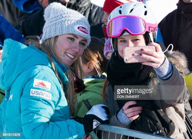 Mikaela Shiffrin of the US poses for selfies after the FIS Ski World Cup Women's Super G on December 3 2017 in Lake Louise Canada / AFP PHOTO / DON...