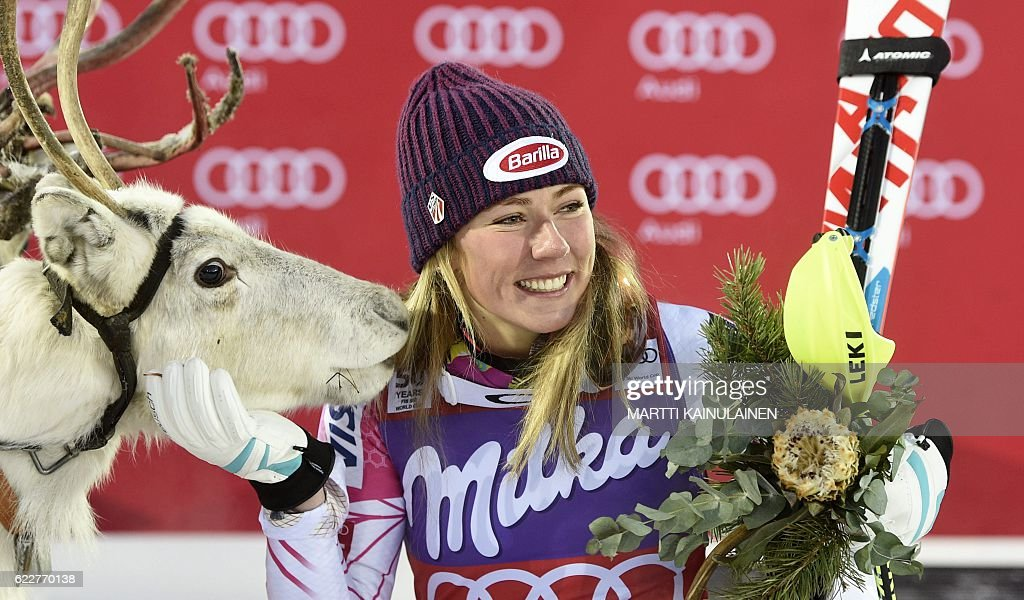 Mikaela Shiffrin of the US poses with a white reindeer named 'Mikaela' she was given after winning the Ladies' FIS Alpine Skiing World Cup slalom race in Levi Kittilä, Finland on November 12, 2016. / AFP / Lehtikuva / Martti Kainulainen / Finland OUT