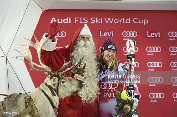 Mikaela Shiffrin of the US poses with Santa Claus and his reindeer after winning the Ladies' FIS Alpine Skiing World Cup slalom race in Levi Kittilä...
