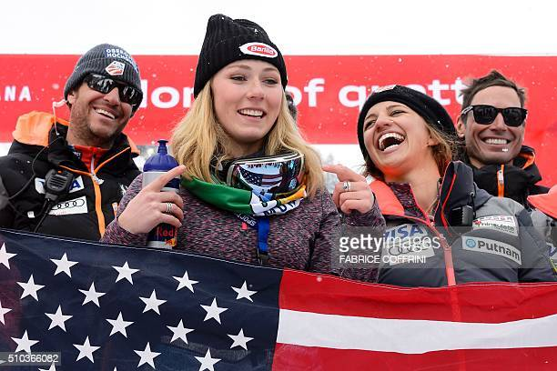 Mikaela Shiffrin of the US smiles for a picture with members of the US Ski team after winning the Women's slalom on February 15 2016 at the FIS...