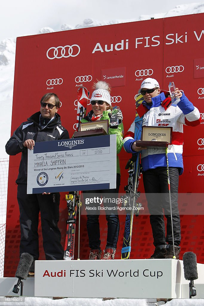 Mikaela Shiffrin (C) of the USA and Alexis Pinturault (R) of France receive the trophy of the best young skier of the season during the Audi FIS Alpine Ski World Cup Nation's Team event on March 15, 2013 in Lenzerheide, Switzerland.