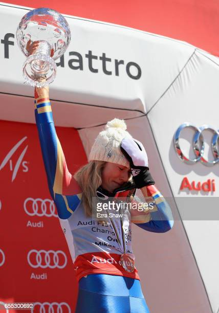 Mikaela Shiffrin of United States reacts after being awarded the globe for being the overall season champion at the 2017 Audi FIS Ski World Cup...