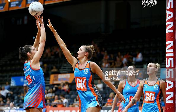 Mikaela Vaughn of NSW shoots for goal as Teigan O'Shannassy of Canberra defends during round one of the ANL match between Canberra Giants and Netball...