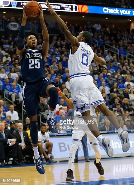 Mikal Bridges of the Villanova Wildcats attempts a shot as Khadeen Carrington of the Seton Hall Pirates defends during the second half of an NCAA...