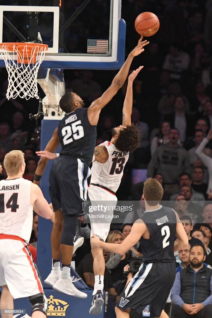 Mikal Bridges #25 of the Villanova Wildcats blocks the shot of Josh Perkins #13 of the Gonzaga Bulldogss during the Jimmy V Classic college basketball game at Madison Square Garden on December 5, 2017 in New York City. The Wildcats won 88-72.