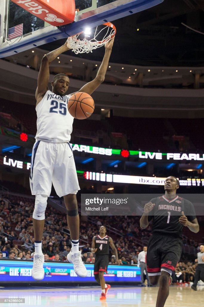 Mikal Bridges #25 of the Villanova Wildcats dunks the ball past Tevon Saddler #1 of the Nicholls State Colonels in the second half at the Wells Fargo Center on November 14, 2017 in Philadelphia, Pennsylvania. The Villanova Wildcats defeated the Nicholls State Colonels 113-77.