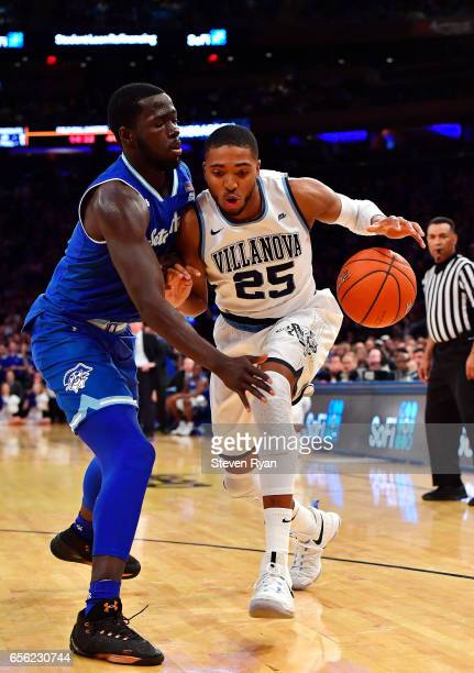 Mikal Bridges of the Villanova Wildcats is defended by Ismael Sanogo of the Seton Hall Pirates during the Big East Basketball Tournament Semifinals...