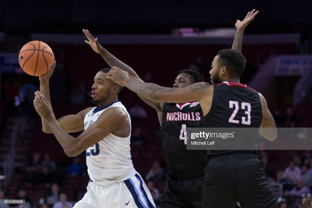 Mikal Bridges #25 of the Villanova Wildcats passes the ball against Zaquavian Smith #4 and Roddy Peters #23 of the Nicholls State Colonels in the second half at the Wells Fargo Center on November 14, 2017 in Philadelphia, Pennsylvania. The Villanova Wildcats defeated the Nicholls State Colonels 113-77.