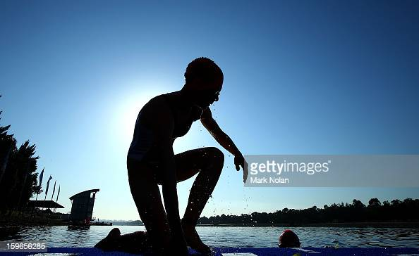 Mikayla Nielsen of New Zealnad warms up before the start of the swim leg in the Womens Triathlon during day three of the 2013 Australian Youth...