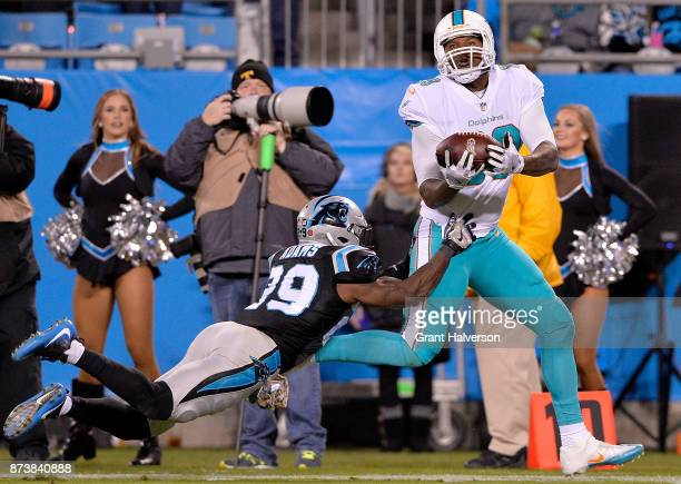 Mike Adams of the Carolina Panthers defends a pass to Julius Thomas of the Miami Dolphins in the second quarter during their game at Bank of America...