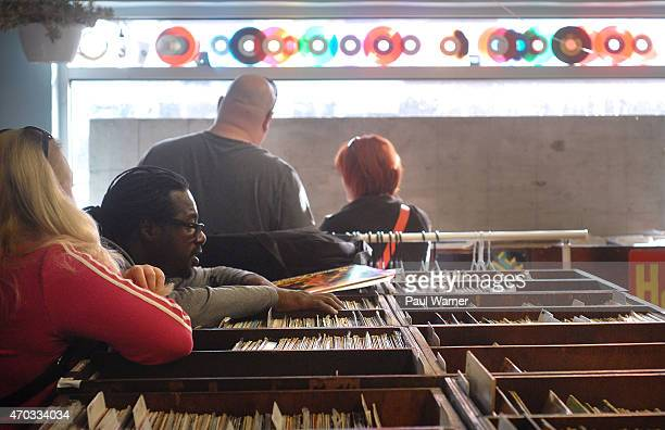 Mike Agent X Clark looks for records at Peoples Records on Record Store Day at on April 18 2015 in Detroit Michigan