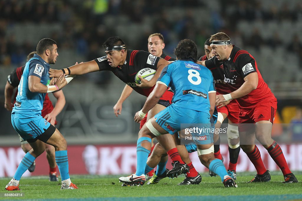 Mike Alaalatoa of the Crusaders fends off Bryn Hall of the Blues during the round 14 Super Rugby match between the Blues and the Crusaders at Eden Park on May 28, 2016 in Auckland, New Zealand.